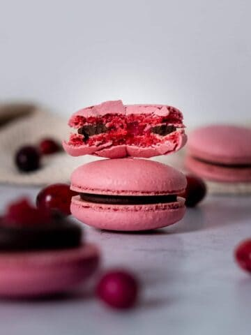 Chocolate cranberry macarons with a bite