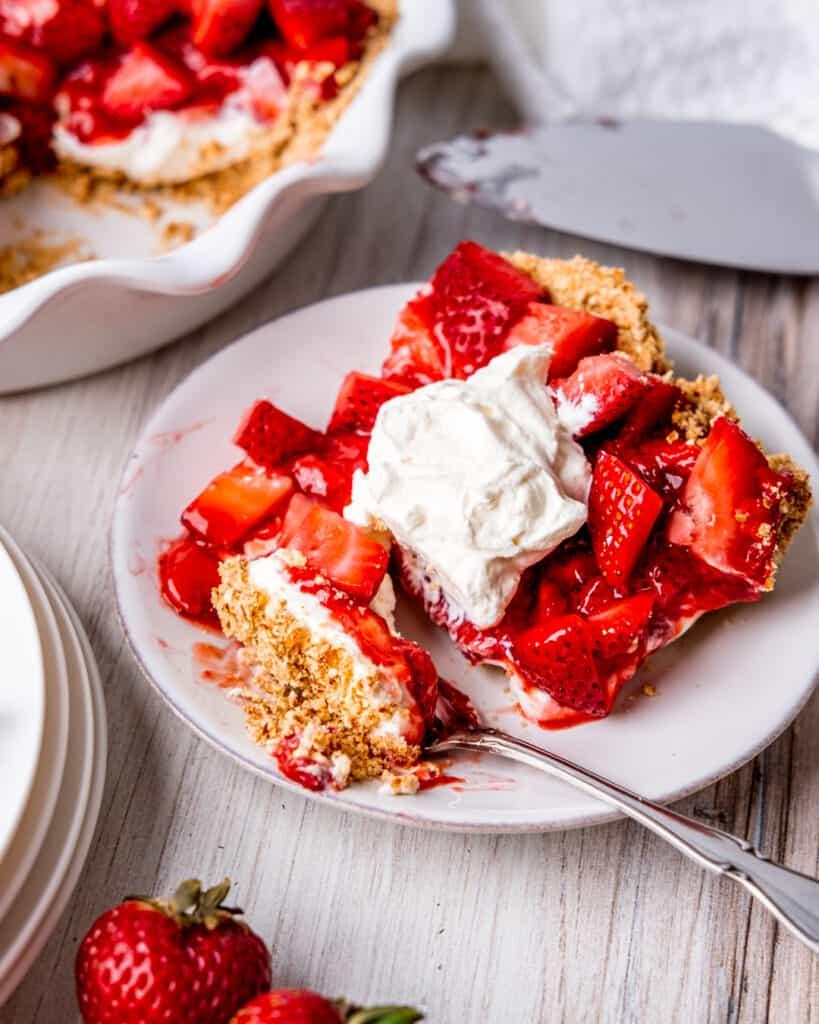 A slice of strawberry cream cheese pie