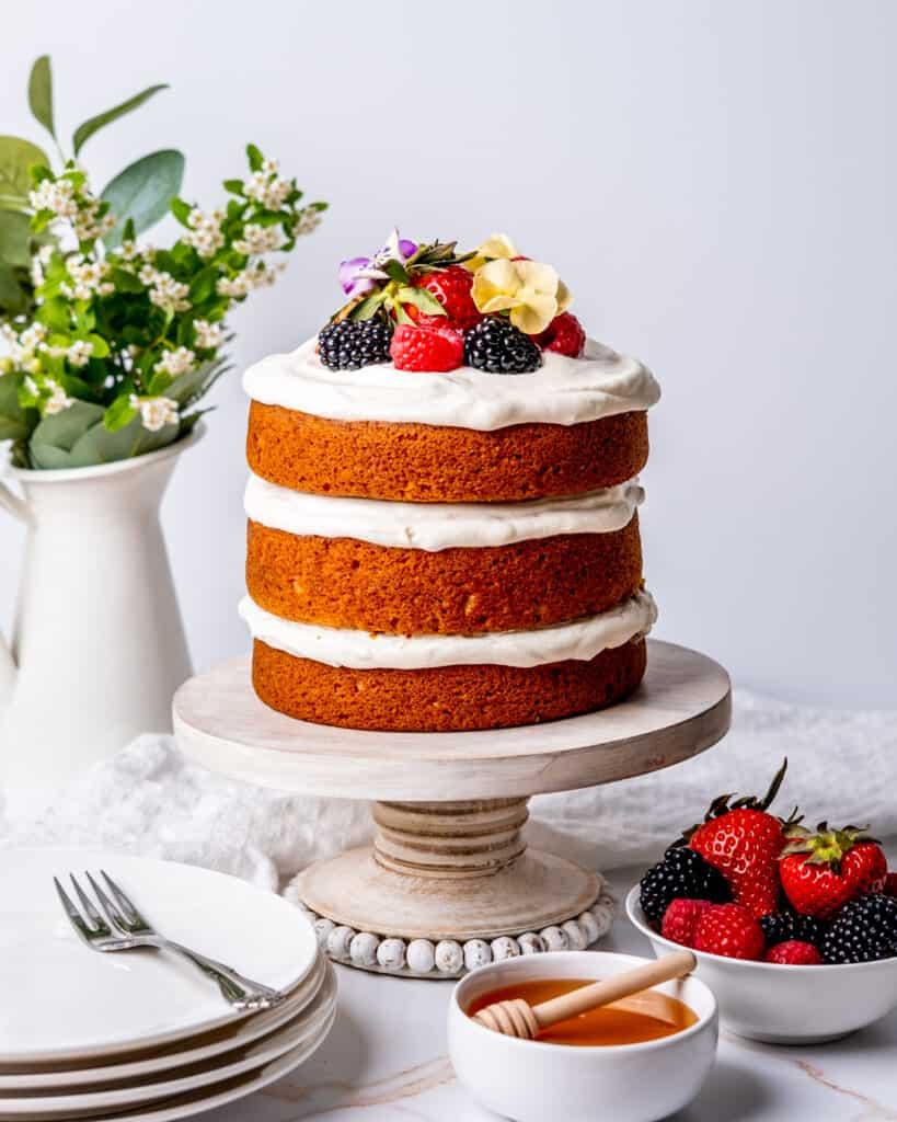 three layer honey cake with whipped cream and fresh fruit