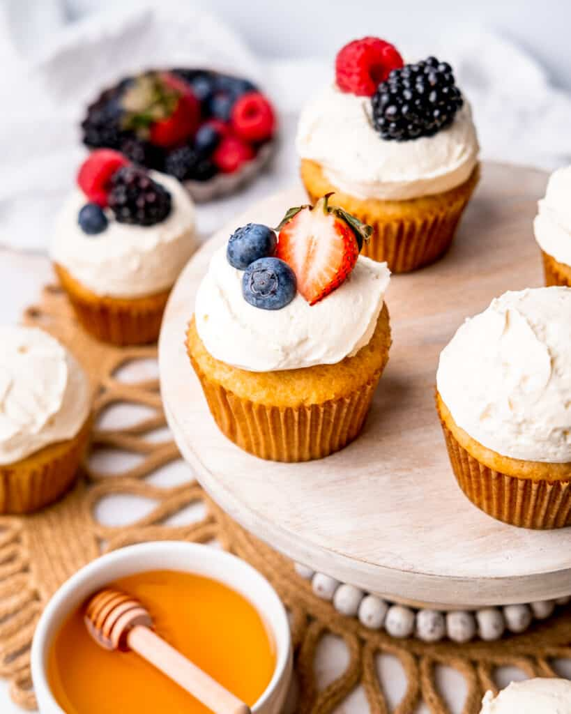 Honey Vanilla Cupcakes with whipped cream and fruit