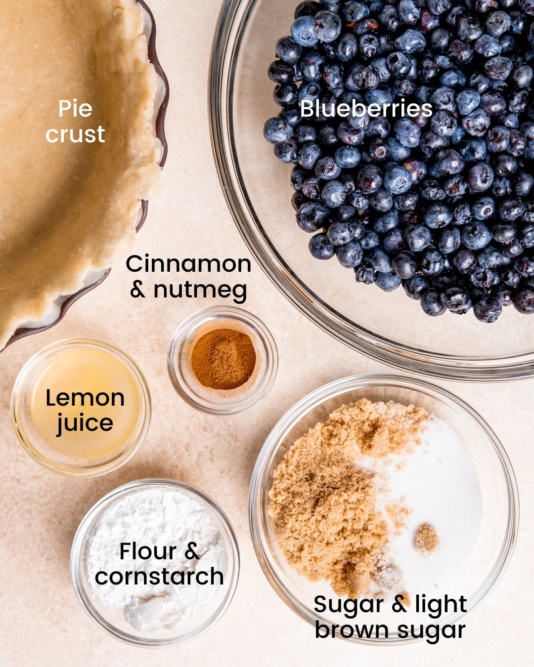 spiced blueberry pie ingredients laid out and labeled