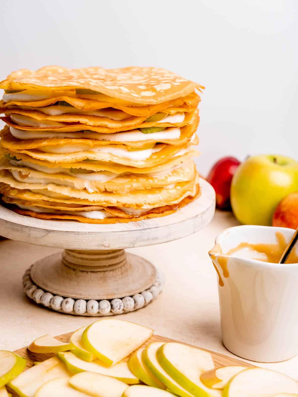 caramel apple crepe cake on a cake stand
