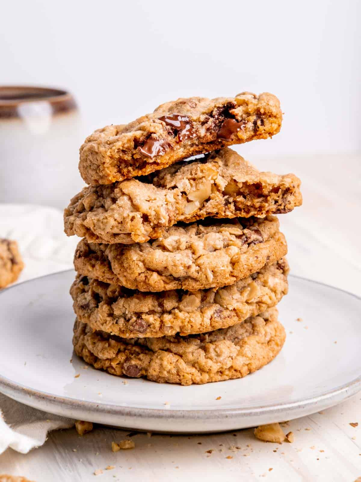 cowboy cookies stacked on a plate