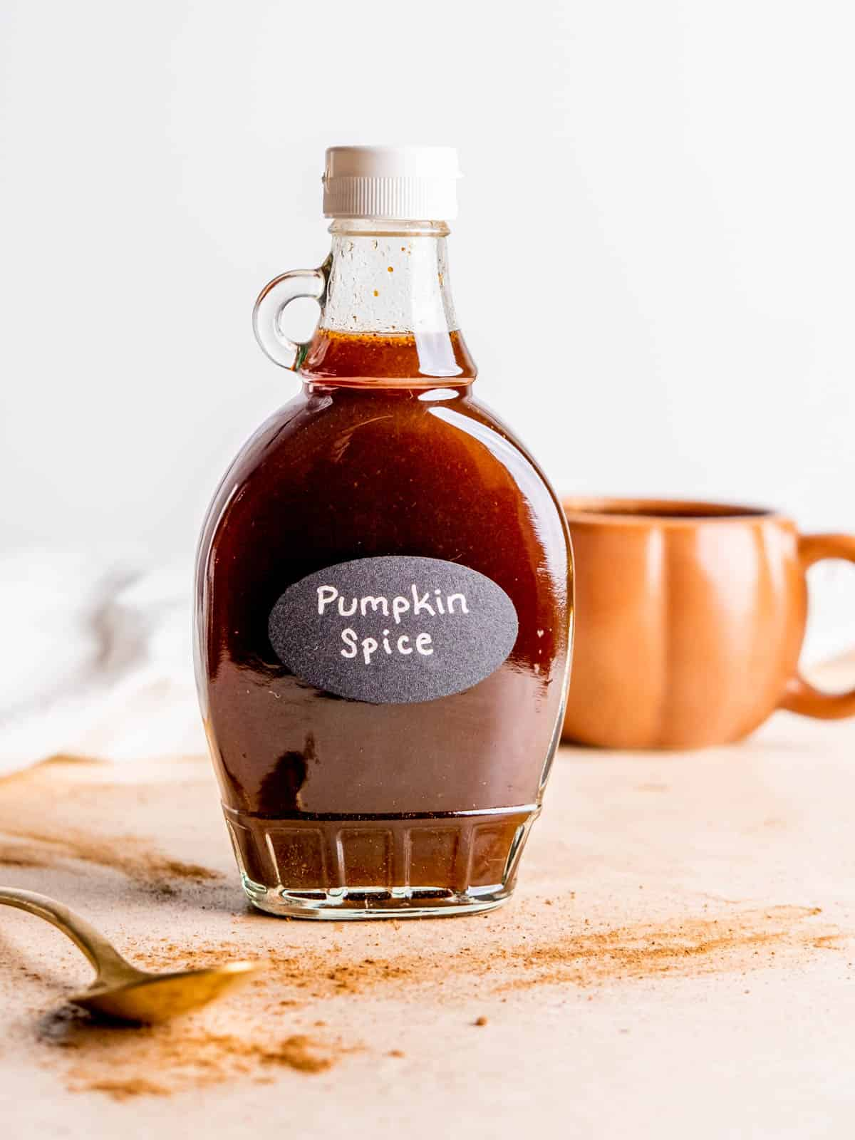 """a syrup bottle filled with pumpkin spice syrup and labeled """"Pumpkin Spice"""""""